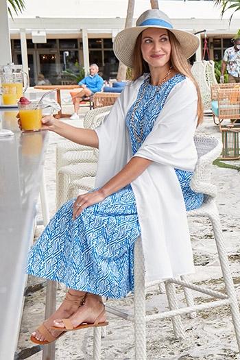 Womens Garden Party - Women sitting at beach bar in dress
