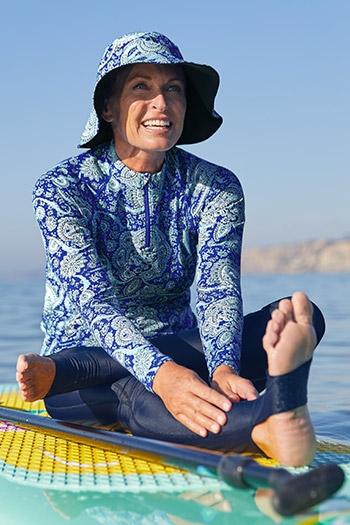 Womens Swim - Woman on surfboard