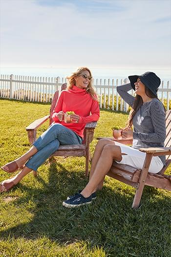 Womens Relaxing - 2 women sitting in chair on beach